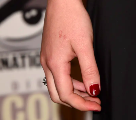 a closeup of her hand and a faint h20