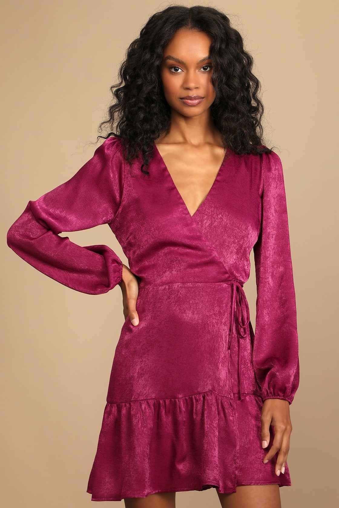 model wearing the pink satin long-sleeved wrap dress