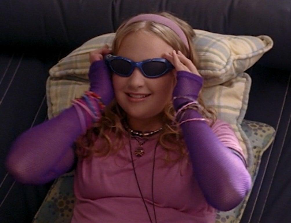 Amy Bruckner lounges on a hammock wearing her cinespecs