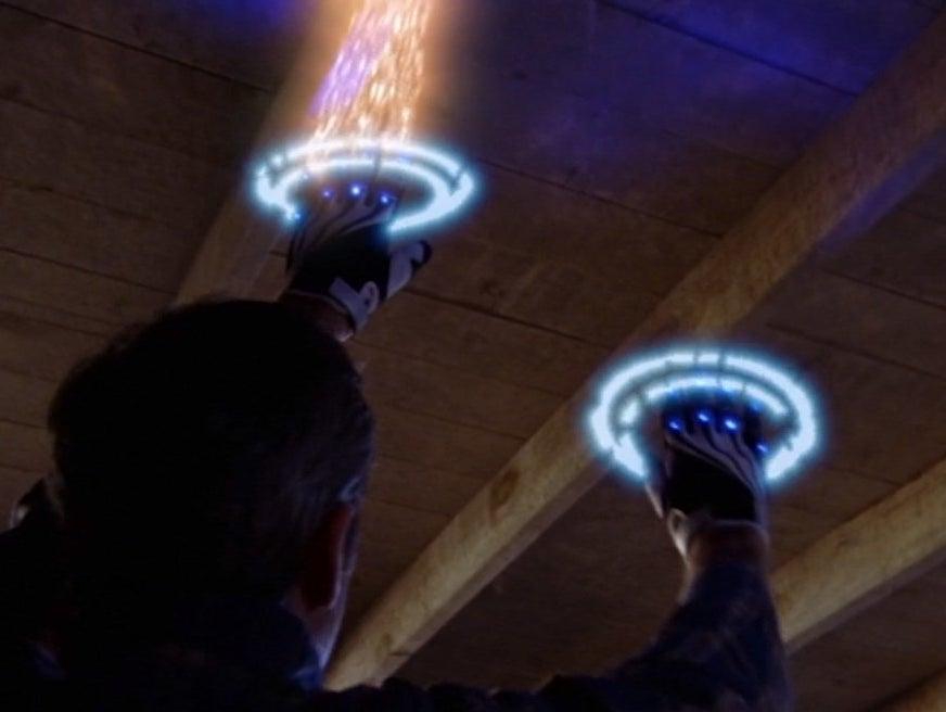Craig Anton hangs from the ceiling using his omnimatic grabifiers