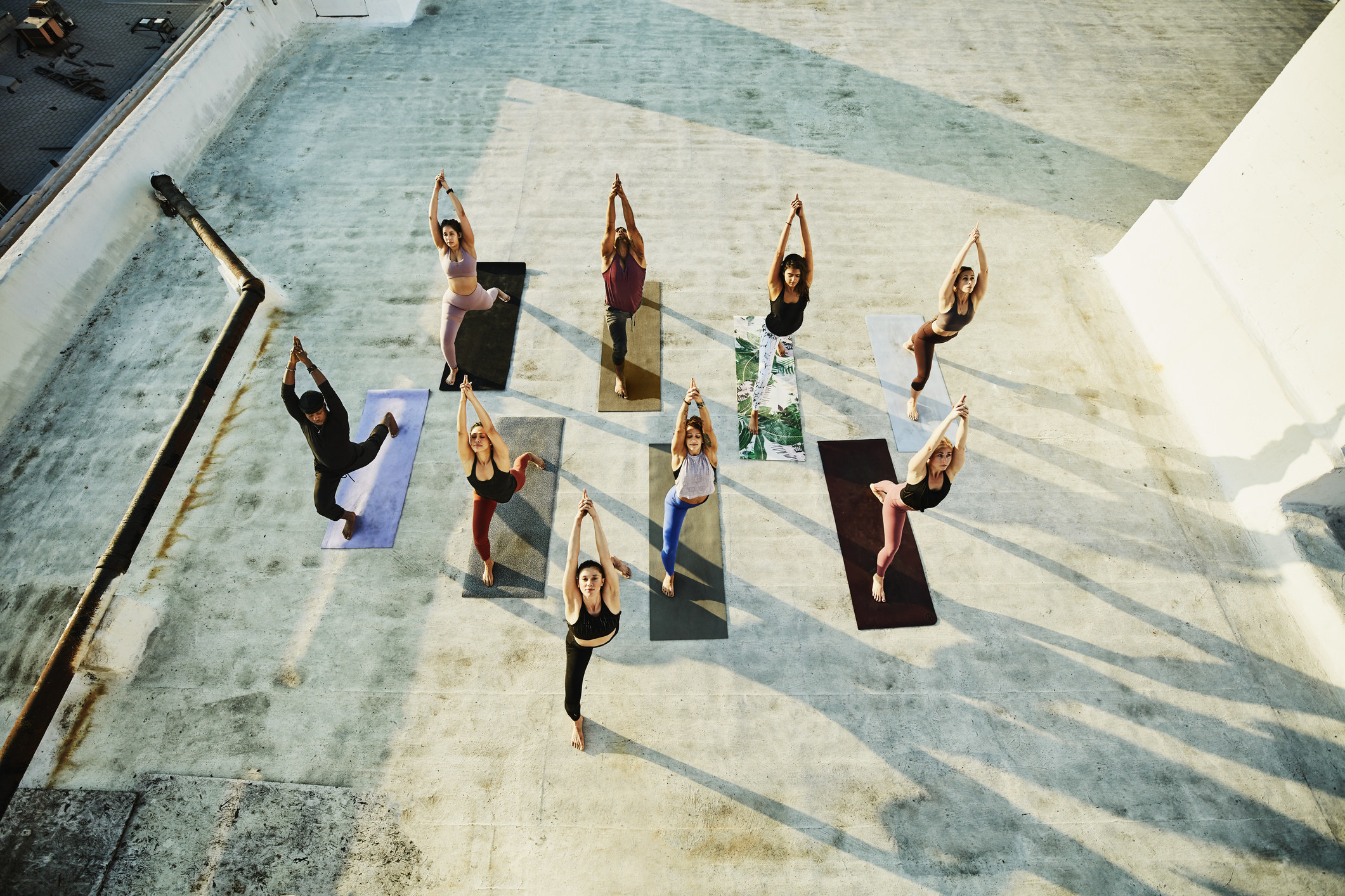 A group of people doing yoga from an aerial view.