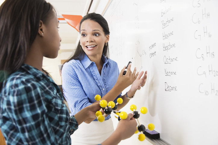 Chemistry teacher smiling at student