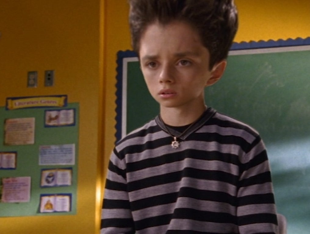 Ricky Ullman with a massive head sits in a classroom