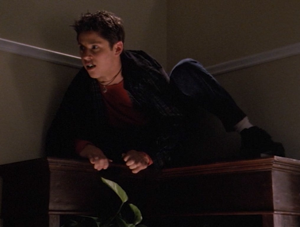 Ricky Ullman with the brain of a caveman on top of a cabinet