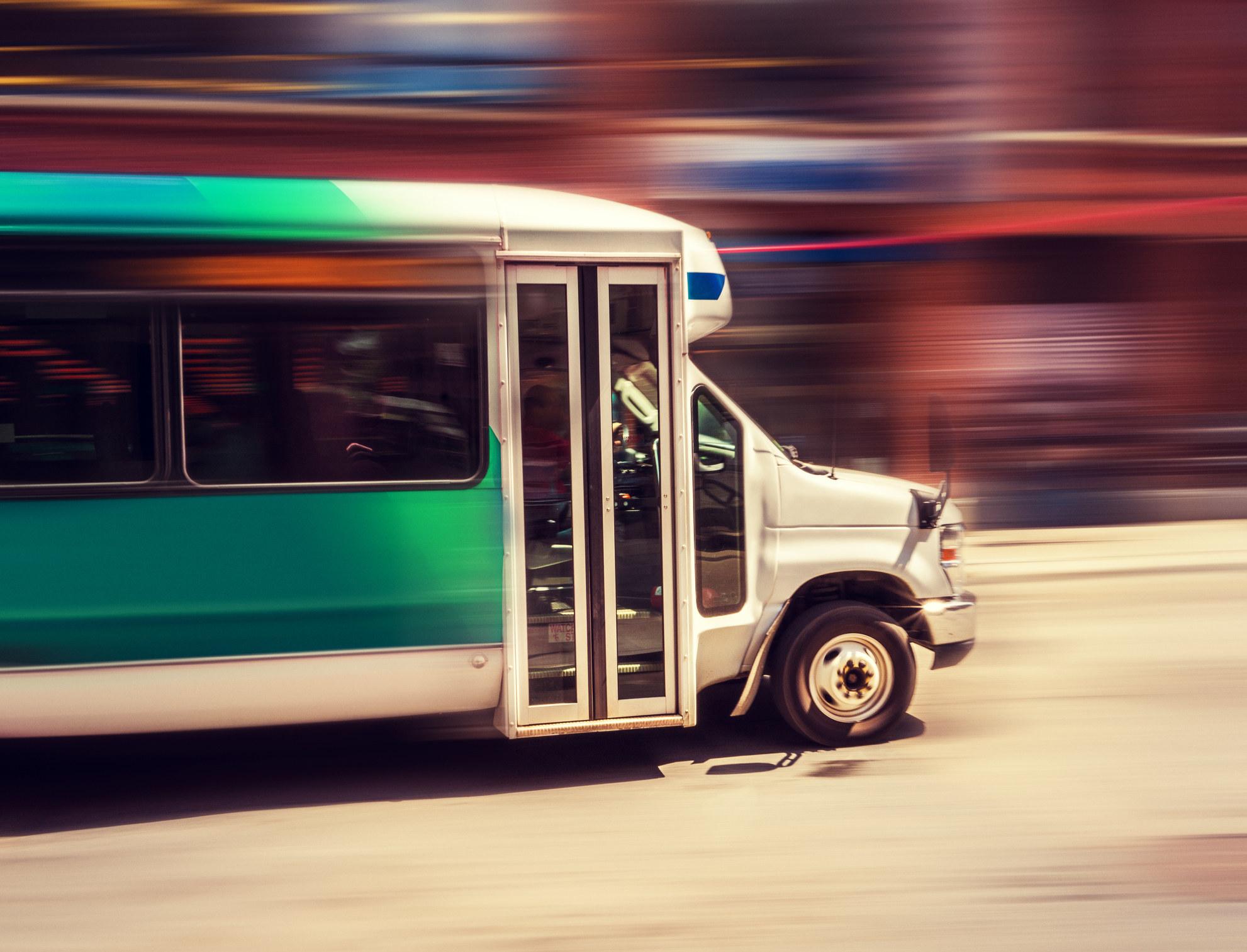 A shuttle bus in motion.