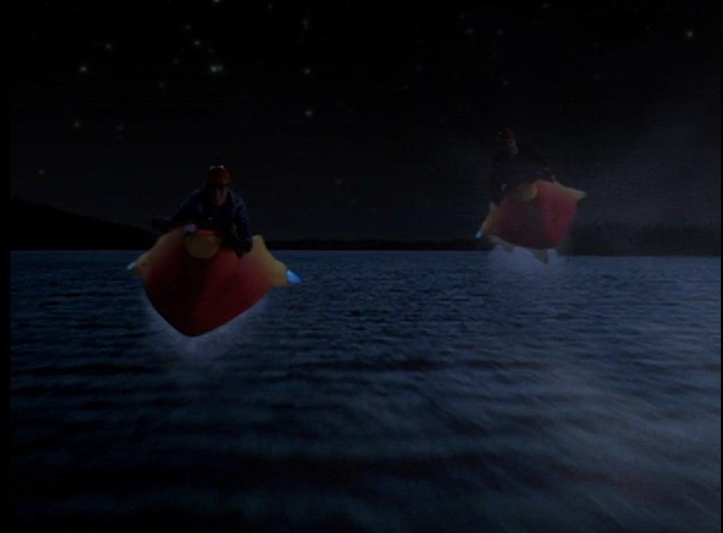 Craig Anton and Ricky Ullman fly over water on skyaks