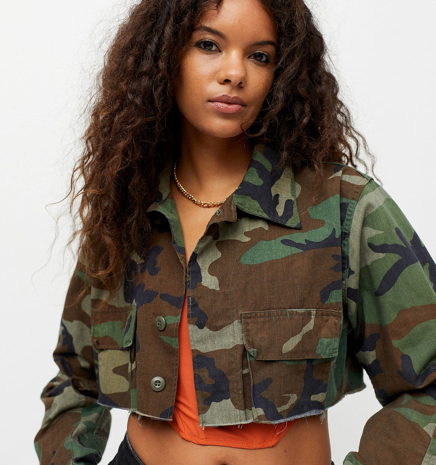 a person wearing a cropped camo jacket