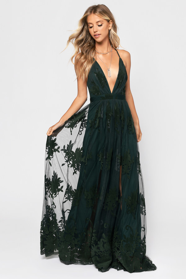 model wearing the maxi plunging v-neck dress in dark green with floral lace overlay