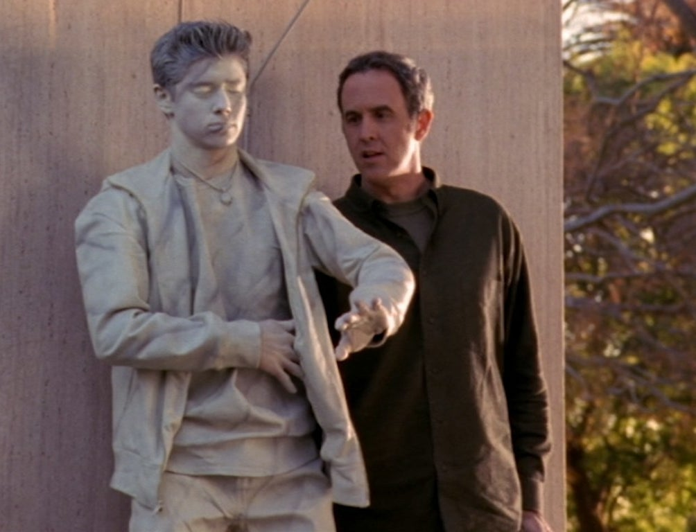 Craig Anton stands next to a statue version of Ricky Ullman