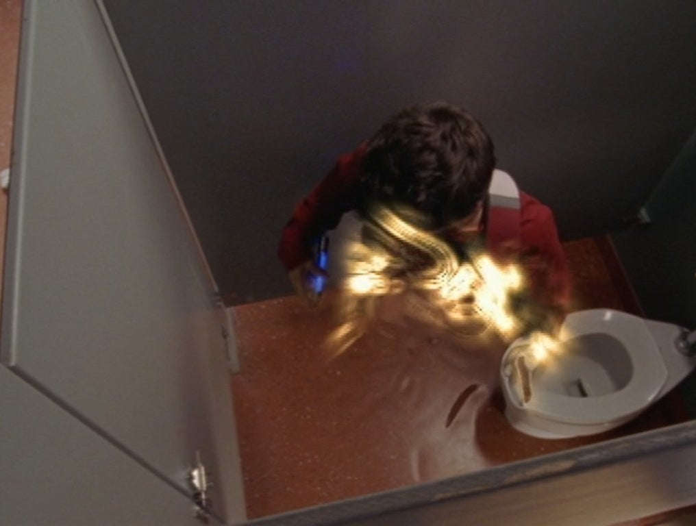 Ricky Ullman becoming invisible in a bathroom stall