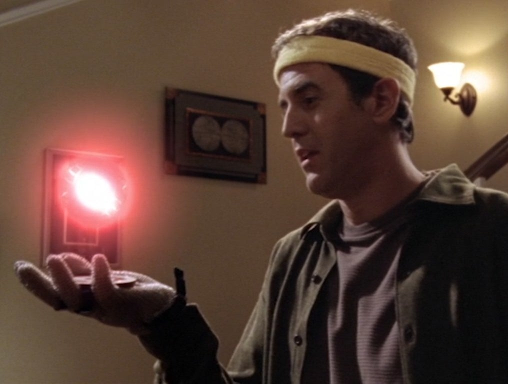 Craig Anton holds a glowing orb