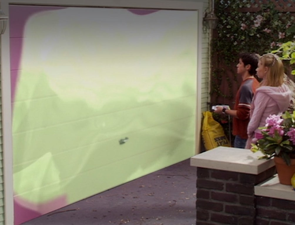 Ricky Ullman and Aly Michalka change the color of a garage door from purple to green