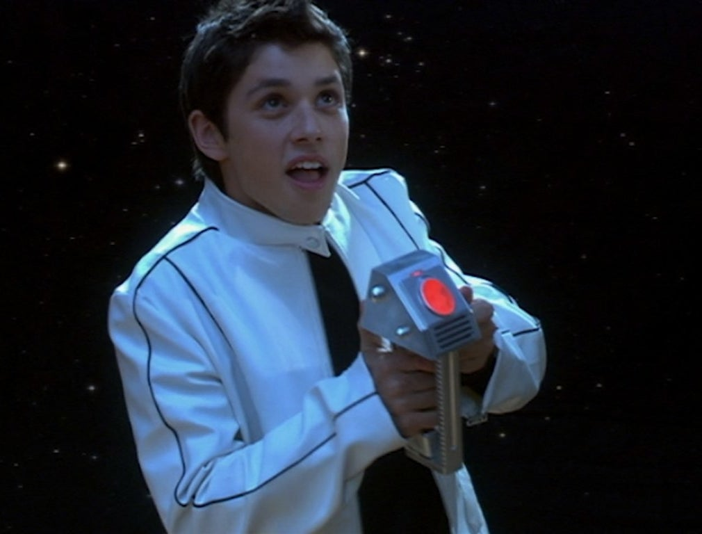 Ricky Ullman holds a remote control