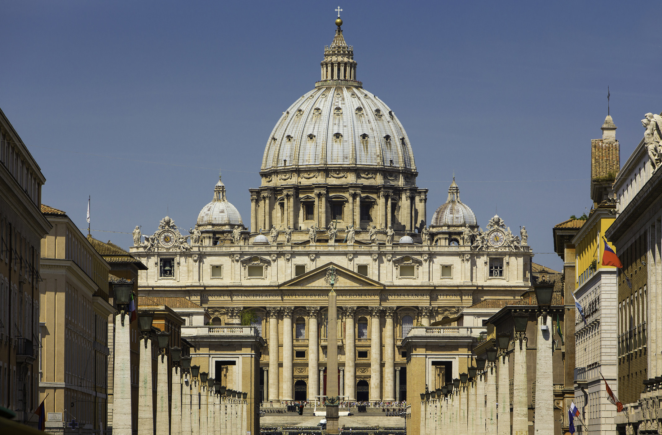A wide shot of the Vatican during daytime.