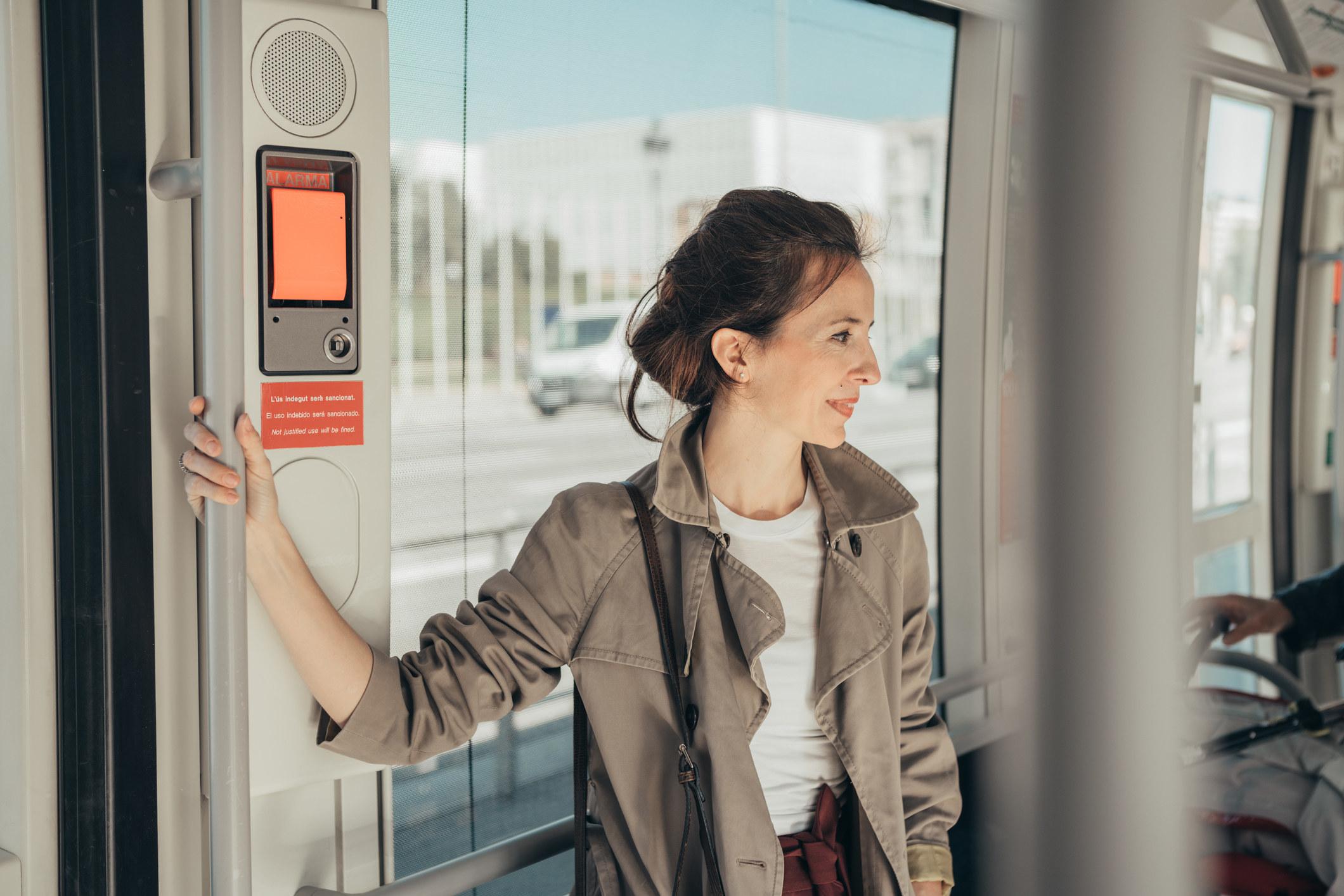 A woman riding public transportation.