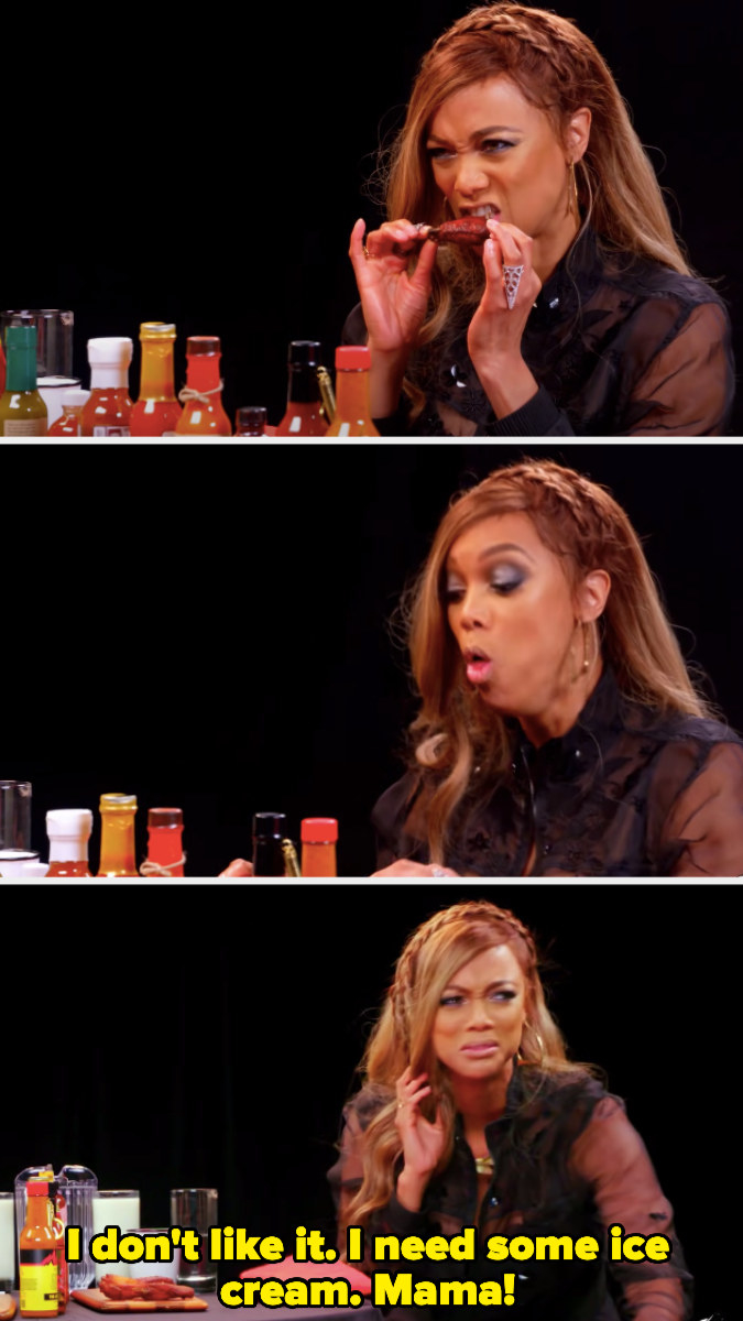 Tyra Banks having an immediate negative reaction after eating a spicy wing and calling for her mother to bring her ice cream
