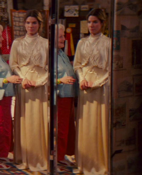Margaret wearing a very old timey, long-sleeve dress