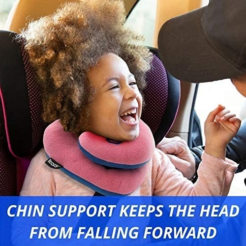 """A model wearing the neck pillow in a car seat with the words """"Chin support keeps the head from falling forward"""" on the image"""