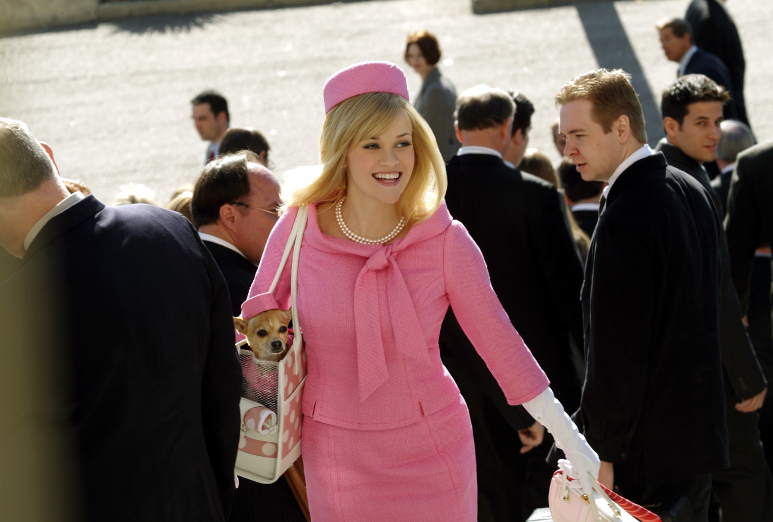 Elle wears a pink suit to court, and Bruce has a matching hat