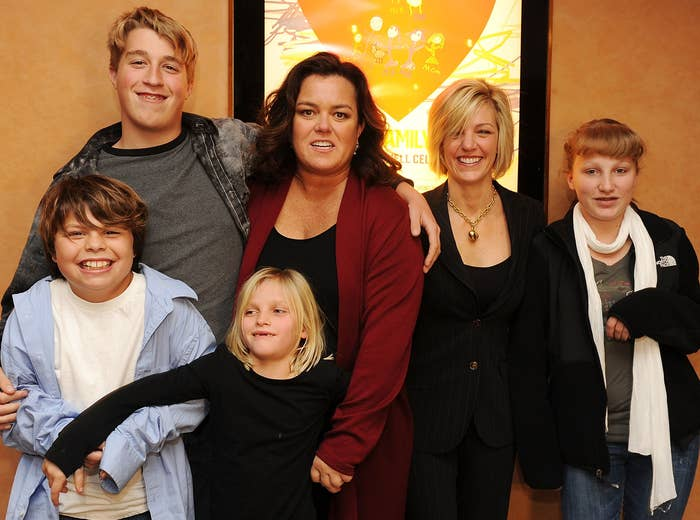 Rosie poses with all her children in an old photo