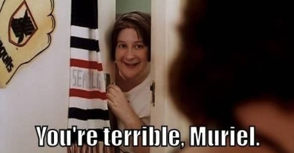 """A woman peeping through a door; it is captioned """"You're terrible, Muriel"""""""