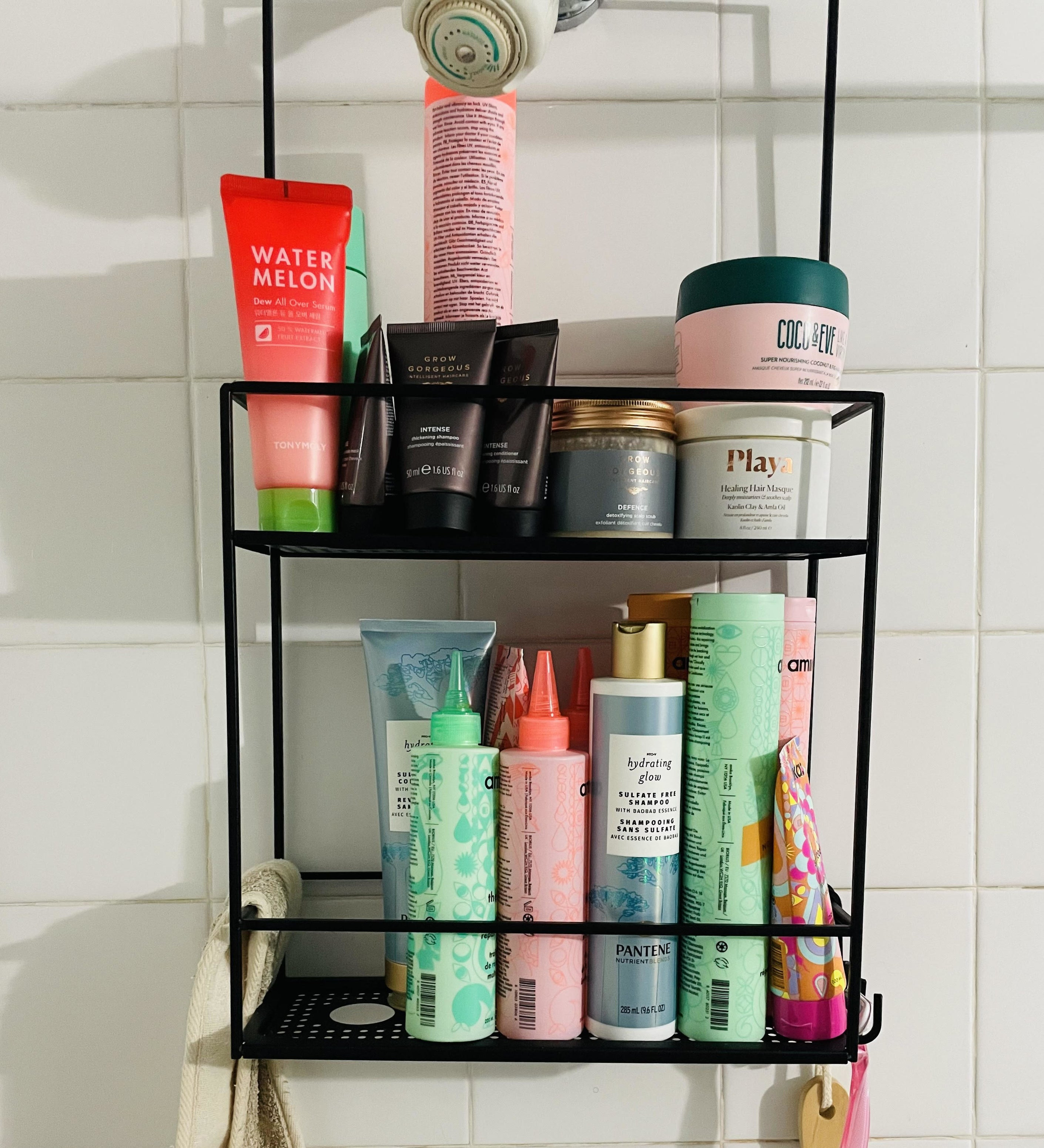 The shower caddy in a shower filled with products