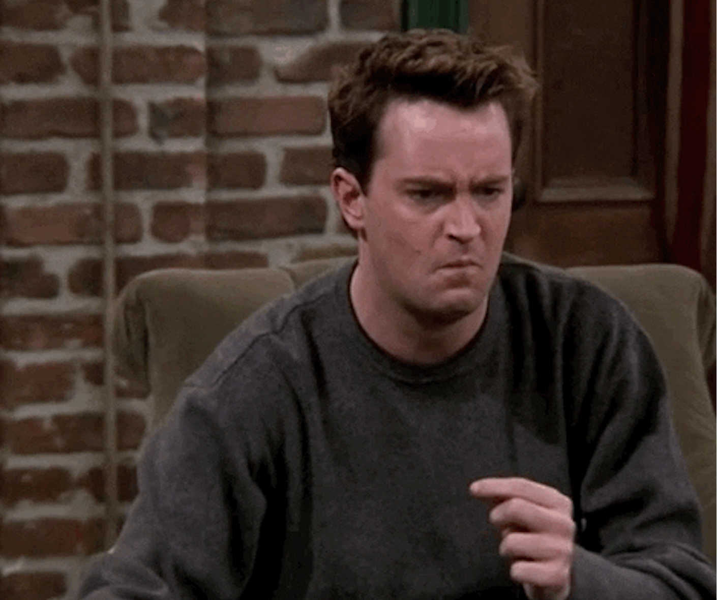Grossed out Chandler Bing about to spit something out