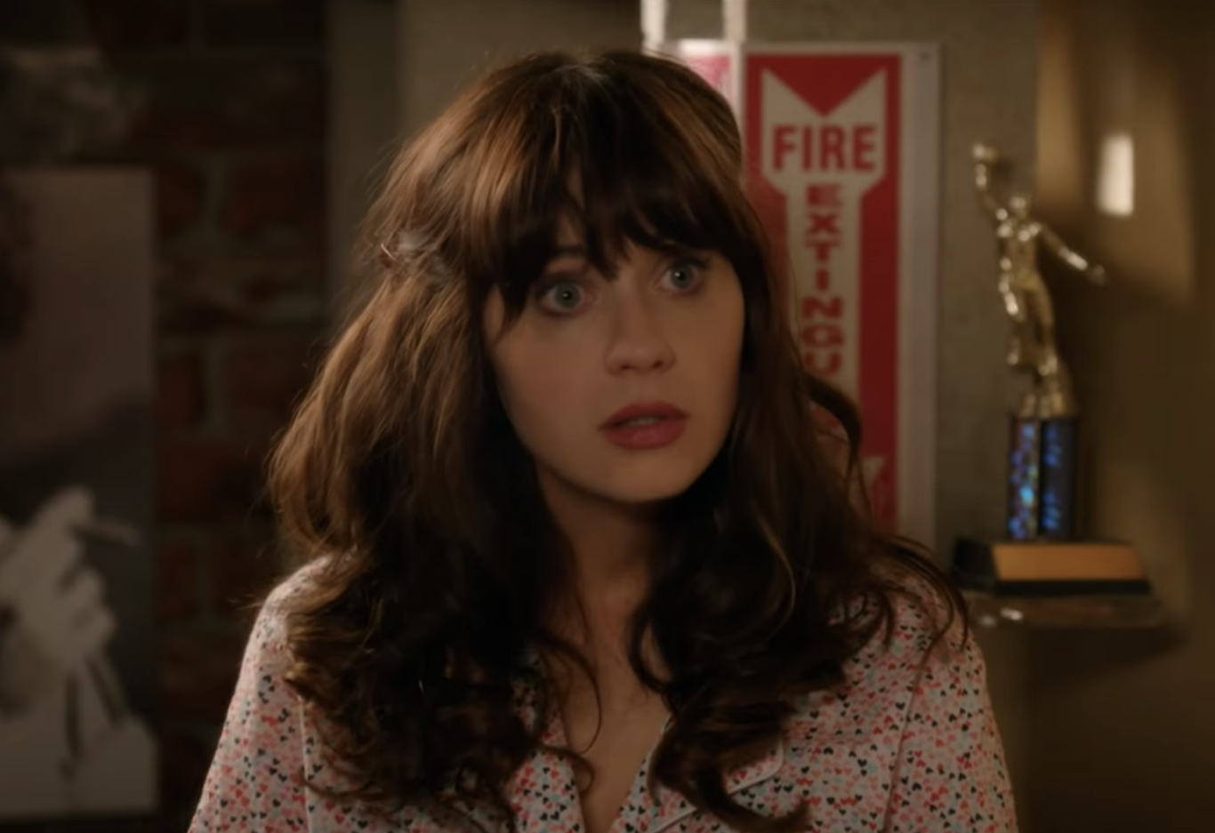 confused Jessica Day in pajamas