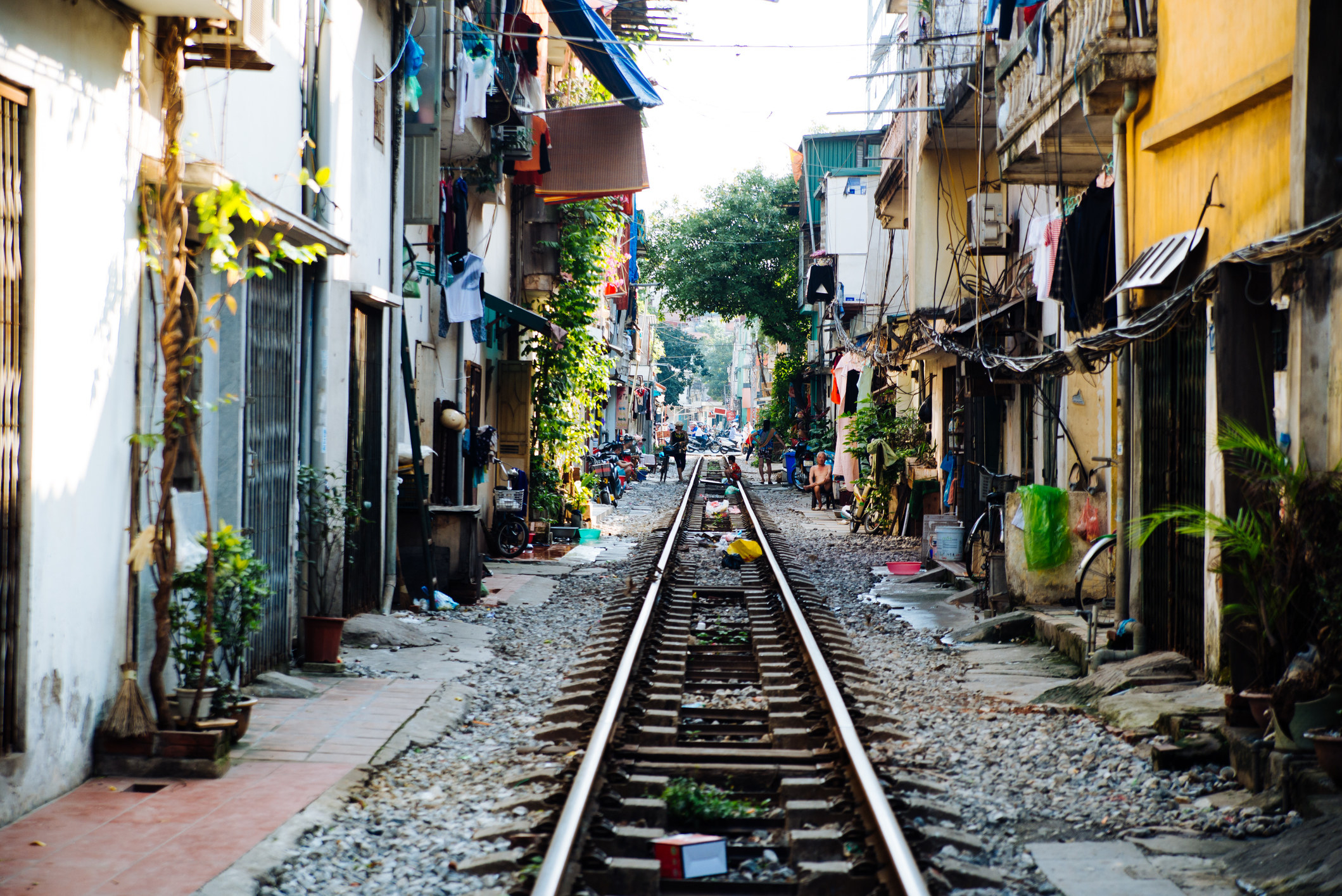 A street with a railroad in Asia.
