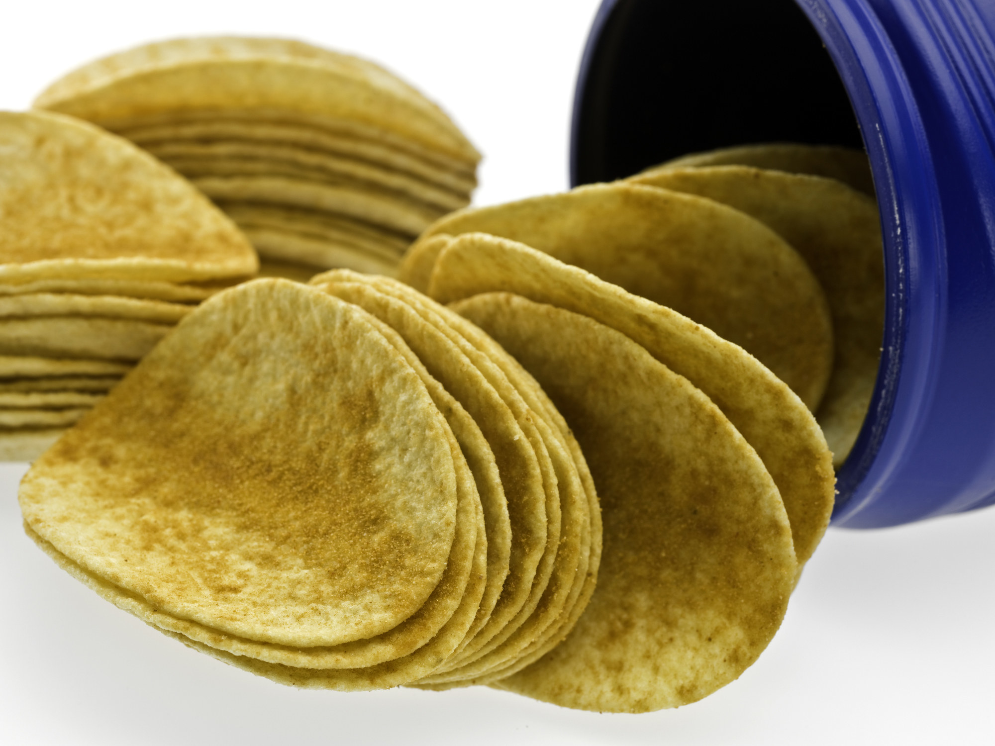 a stack of potato chips spilling out of a can