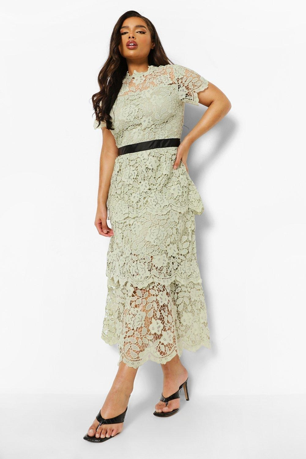 model wearing the ankle-length tiered lace short-sleeved high-neck dress in light green
