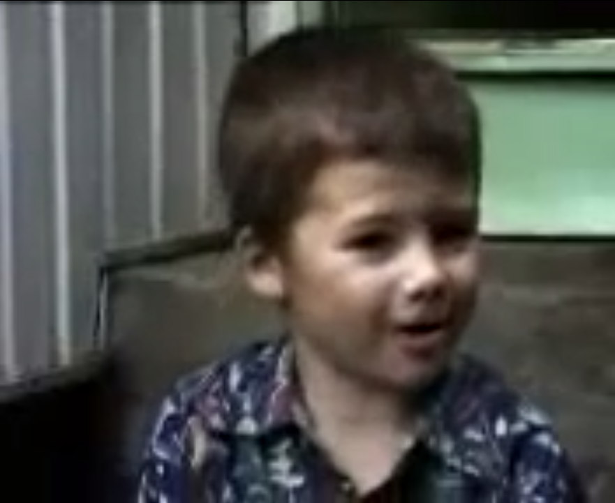 A young boy speaking