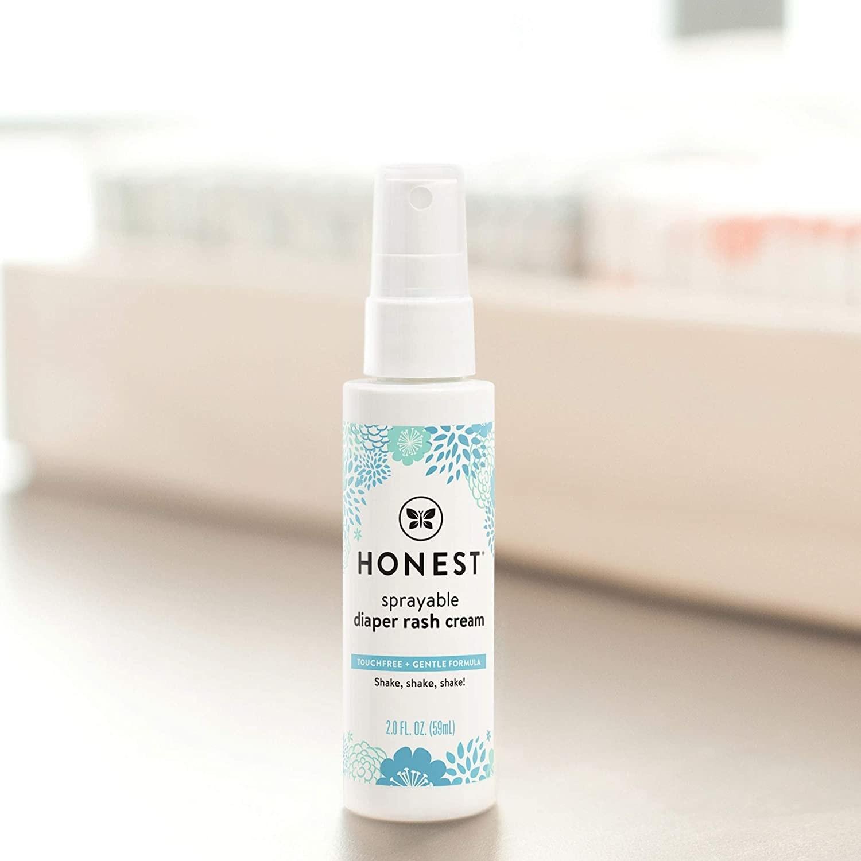 The bottle of diaper rash cream spray
