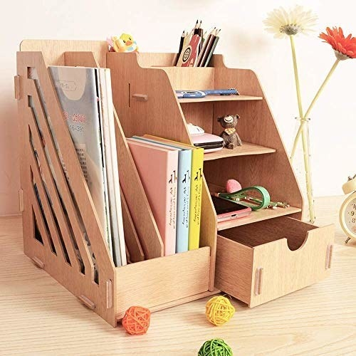 The wooden desk organiser with books, stationer and other tidbits on it