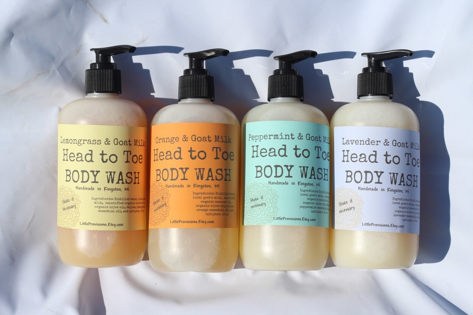 Four bottles of body wash in lemongrass, orange,peppermint and lavender scents