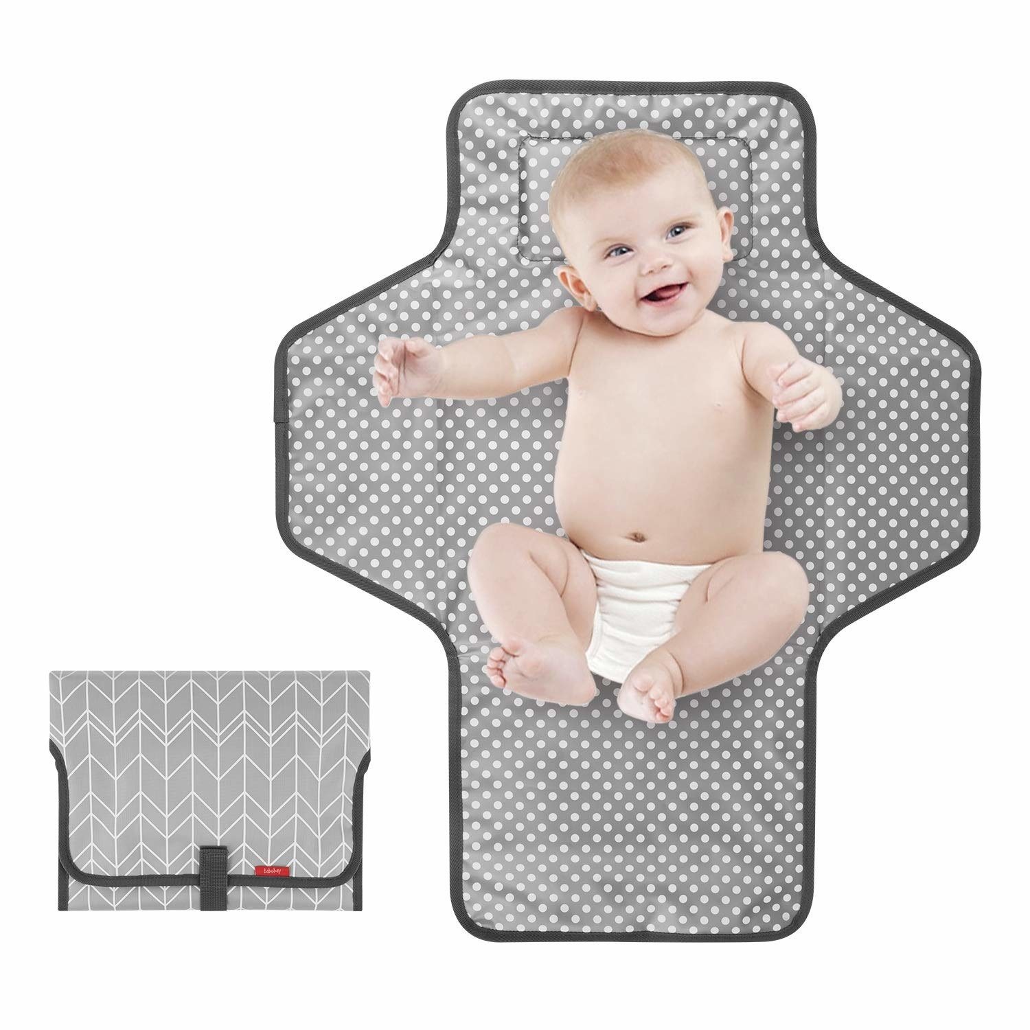 The grey patterned changing mat with a baby and folded up