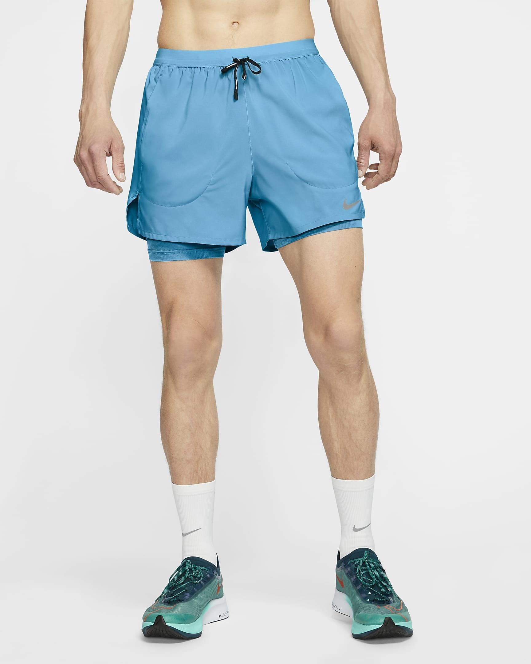 Model wearing blue Nike stride shorts