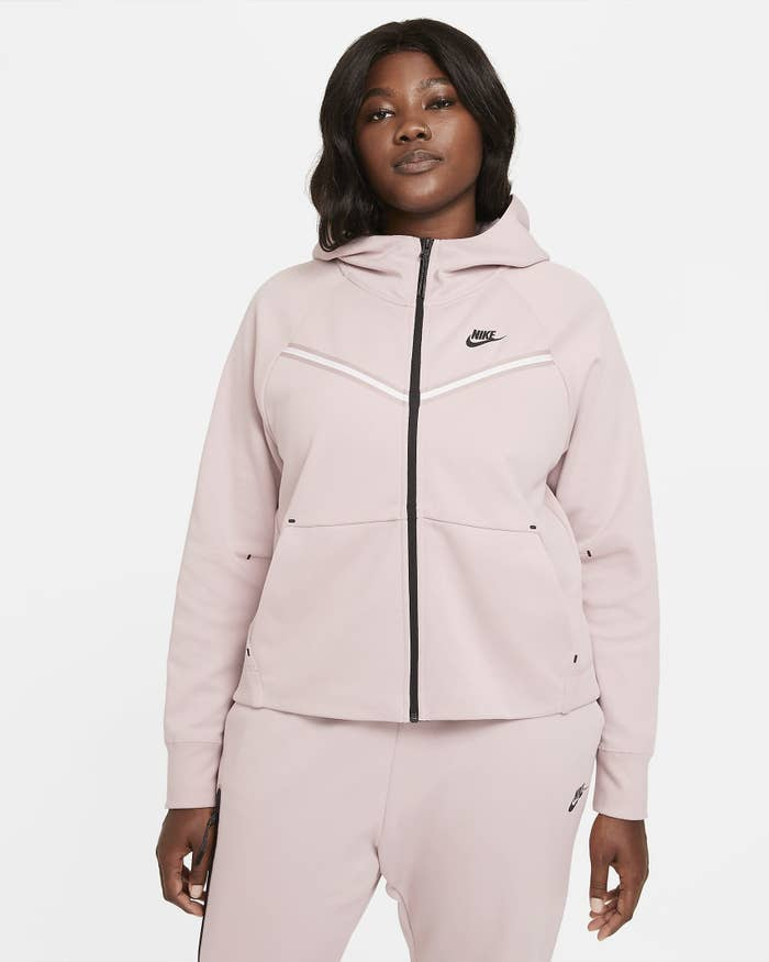 Model wearing pink wind runner jacket with matching pants
