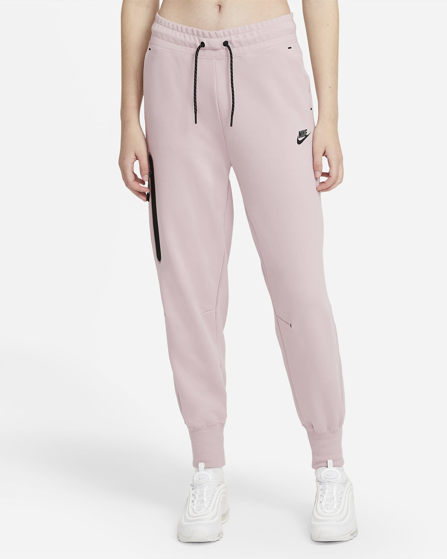 Model wearing pink fleece joggers with white sneakers