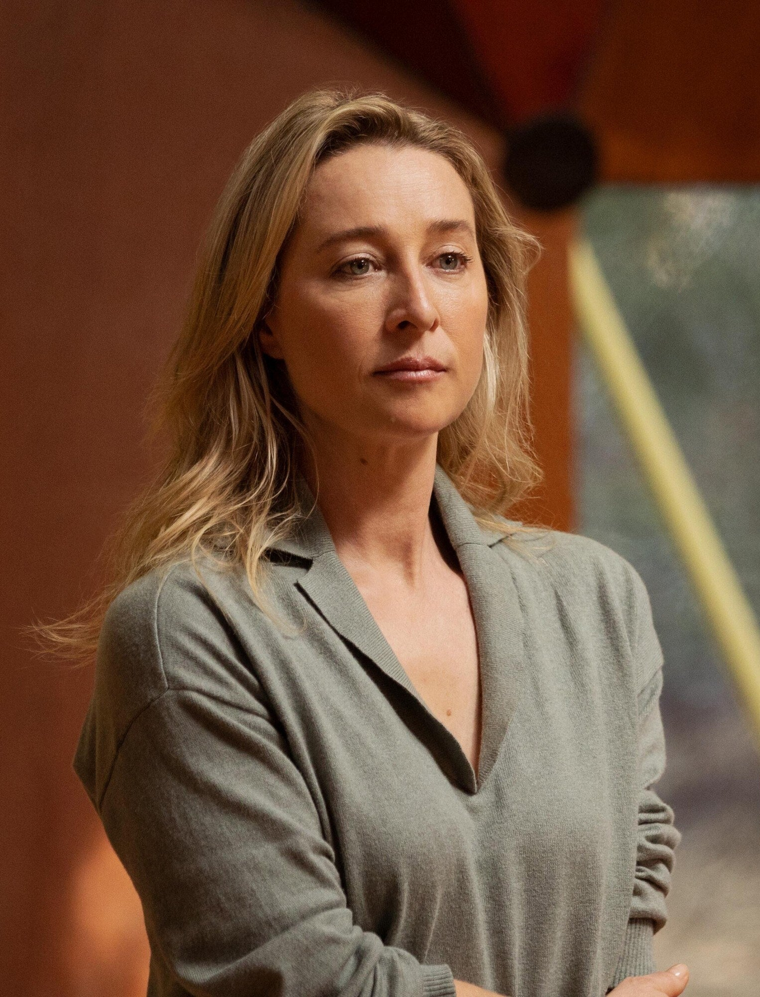 Asher Keddie stands in a group meeting