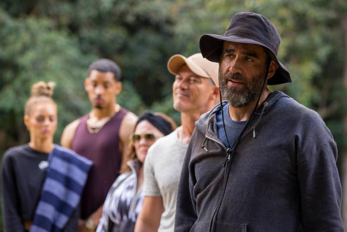 Samara Weaving, Melvin Gregg, Melissa McCarthy, Luke Evans, and Bobby Cannavale stand together in the woods