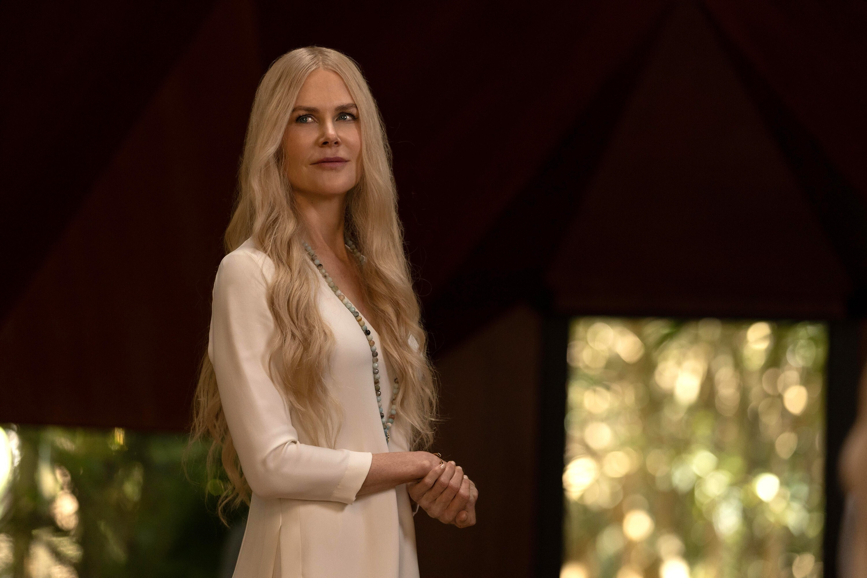 Nicole Kidman with long blonde hair looks at the guests