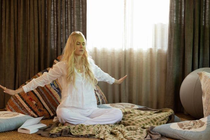 Nicole Kidman meditating on the floor