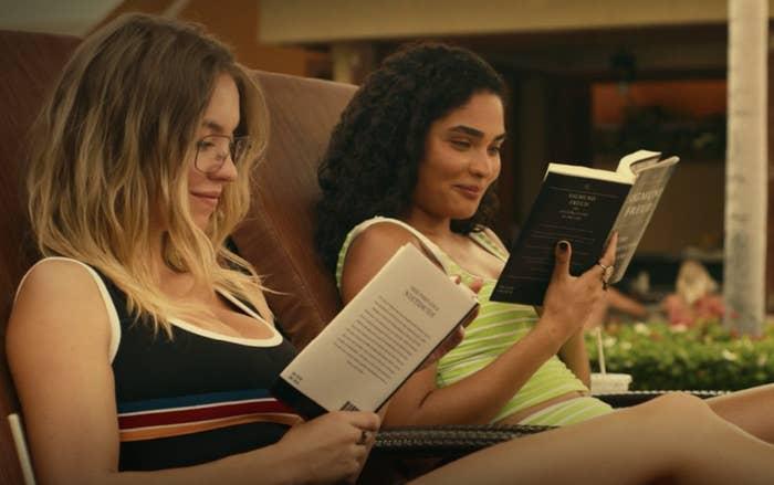 Olivia and Paula read poolside