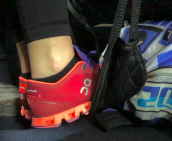 A customer review photo of them using the footrest on an airplane