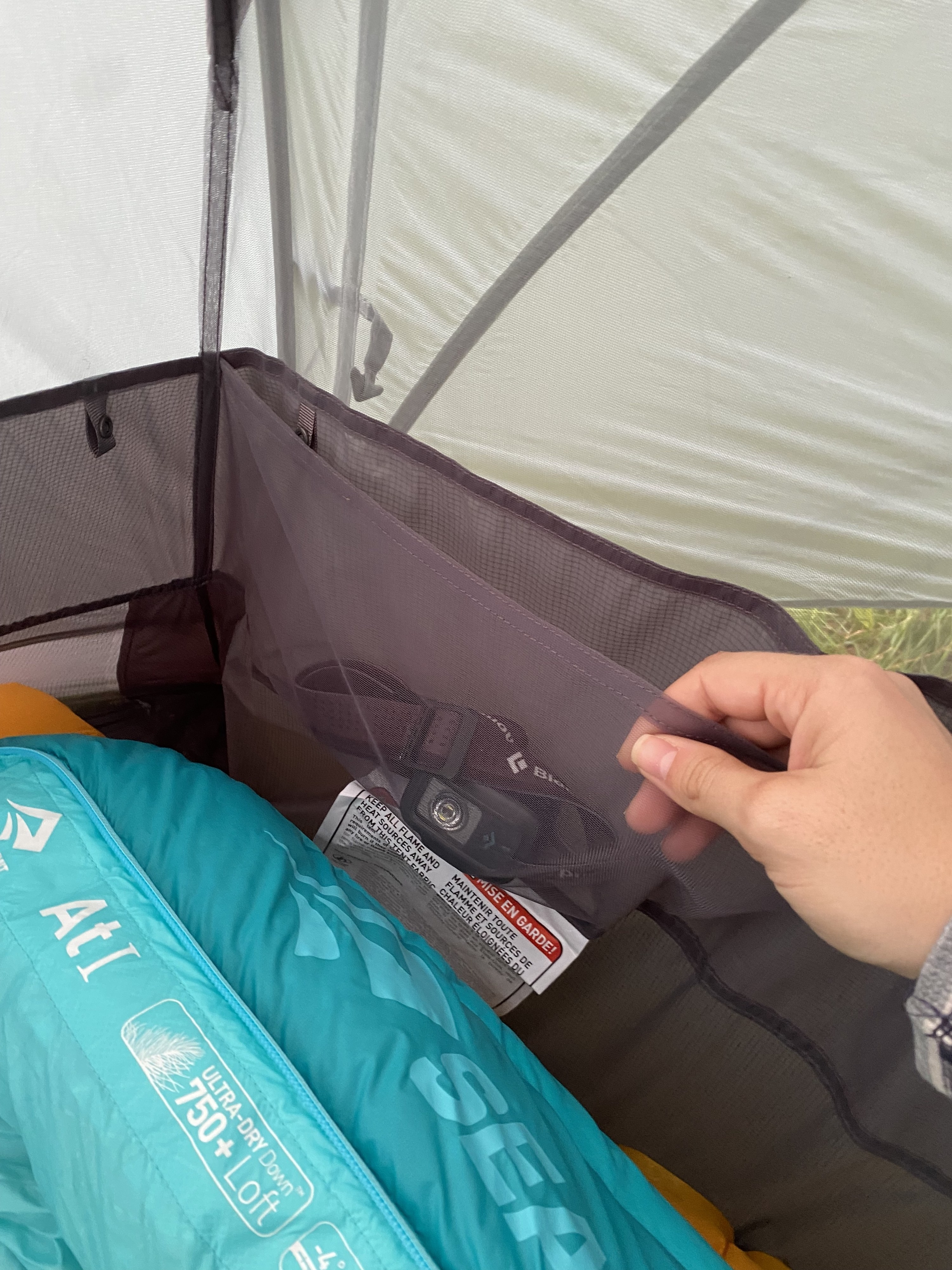 the pouch in the tent with a headlamp in it