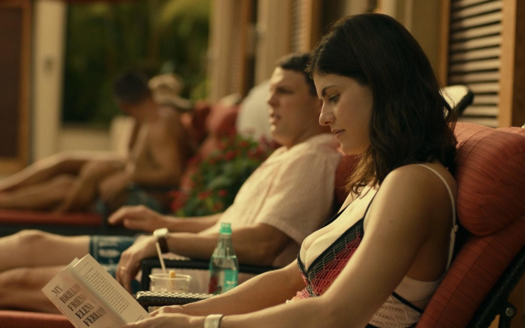 Rachel reads poolside in chaise
