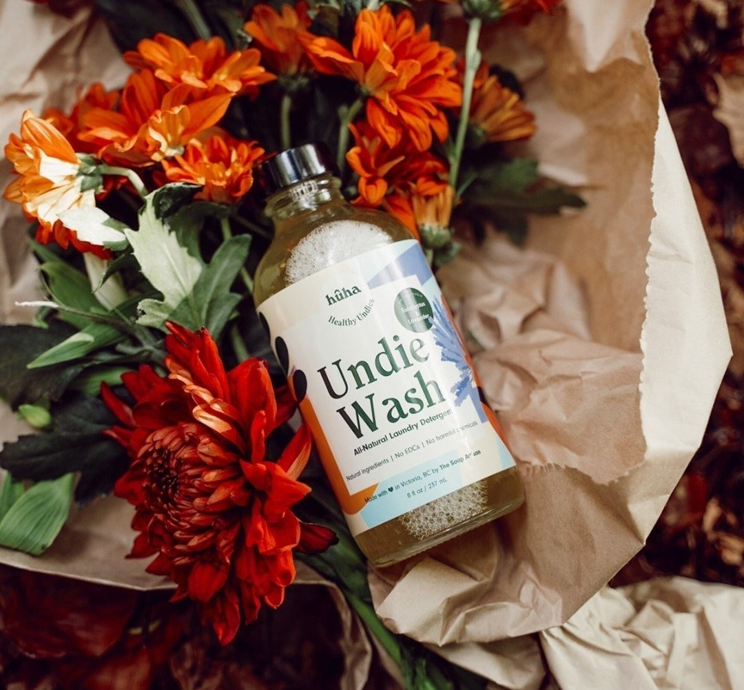 A flatlay of the undie wash on a bouquet of fresh cut flowers