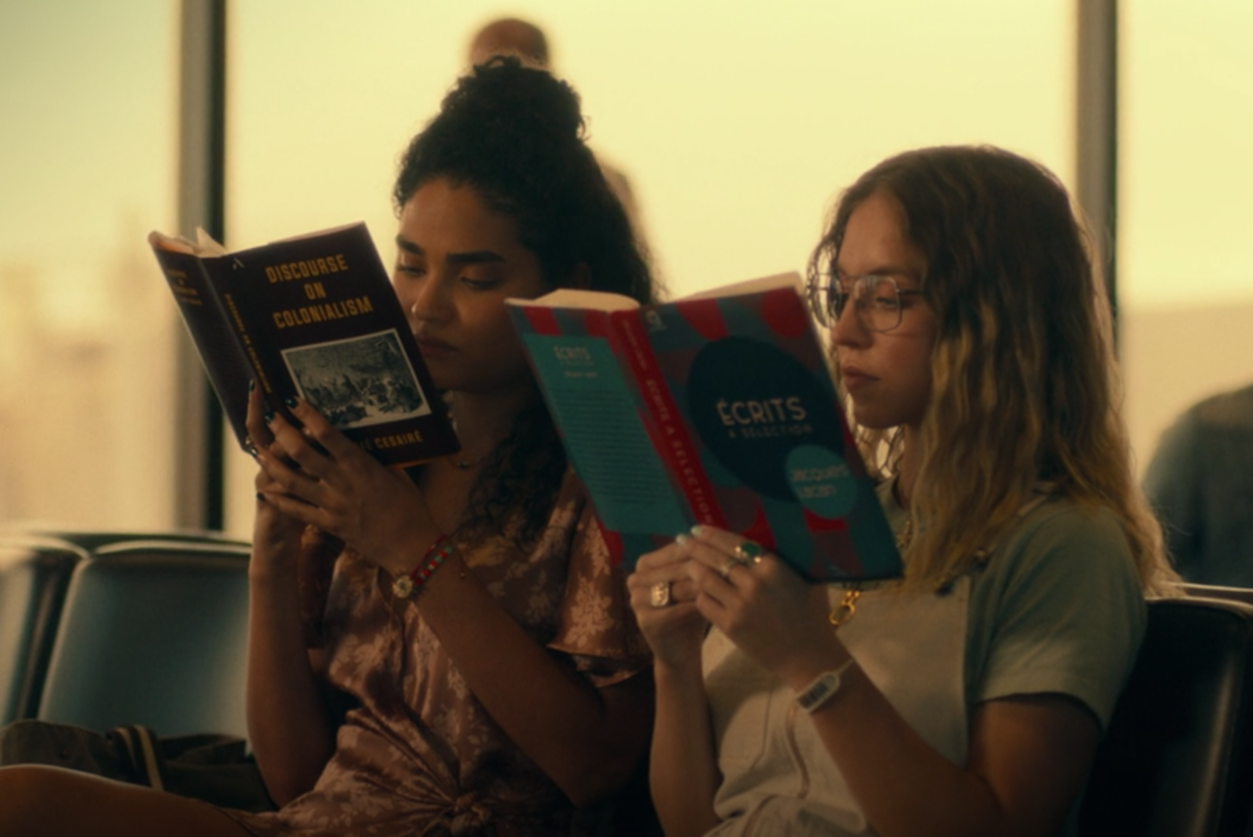 Olivia and Paula read in the airport