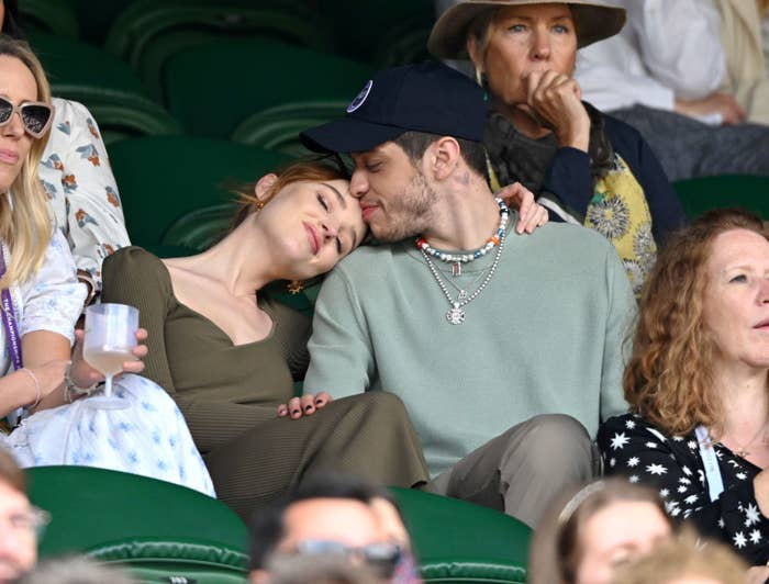 Phoebe and Peter cuddling while watching a tennis match at Wimbledon